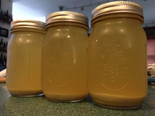 Three jars of Conan yeast harvested from 2.5 gallons of IPA after cold crashing.